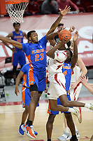 Arkansas guard Davonte Davis (right) reaches to score Tuesday, Feb. 16, 2021, as he is pressured by Florida guard Scottie Lewis (23) during the first half of play in Bud Walton Arena. Visit nwaonline.com/210217Daily/ for today's photo gallery. <br /> (NWA Democrat-Gazette/Andy Shupe)