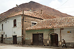 """Old houses in Potosí, Bolivia.  In the background is the infamous Cerro Rico, or """"rich hill"""" of Potosí."""