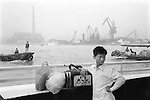 China, Shanghai. There are still numerous ferries that cross the Huangpu river and until the late 1980s was the only way to reach Pudong.  The ferries go every 10 minutes, take about 10 minutes, and cost 50 mao. This young traveller has on his bag pictures of Princess Huan Zhu from the highly popular film of the same name Huan Zhu Ge-Ge (1999); a Hong Kong-China production.  This is one of those films that has everything - action, comedy, songs, historical drama; and all the most interesting characters (good and bad) are female...