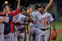 Mesa Solar Sox center fielder Victor Robles (14), of the Washington Nationals organization, congratulates teammates after an Arizona Fall League game against the Scottsdale Scorpions on October 23, 2017 at Scottsdale Stadium in Scottsdale, Arizona. The Solar Sox defeated the Scorpions 5-2. (Zachary Lucy/Four Seam Images)