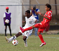 Joseph Amon (12) of the United States clears the ball away from Darwin Pinzon (10) of Panama during the group stage of the CONCACAF Men's Under 17 Championship at Jarrett Park in Montego Bay, Jamaica. The USA defeated Panama, 1-0.