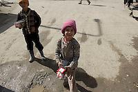 Children selling goods.