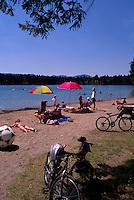 Kikomun Creek Provincial Park, Kootenay Region, BC, British Columbia, Canada - Sunbathing on Beach at Surveyors Lake