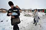 A postal worker makes his way through the Krivac Roma Settlement in Smederevo, Serbia, one of the largest Roma neighborhoods in the Balkans. Many of the residents here arrived as refugees from Kosovo.