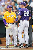 LSU Tigers Head Coach Paul Mainieri (1) exchanges lineup cards with TCU Head Coach Jim Schlossnagle (22) before Game 10 of the NCAA College World Series on June 18, 2015 at TD Ameritrade Park in Omaha, Nebraska. TCU defeated the Tigers 8-4, eliminating LSU from the tournament. (Andrew Woolley/Four Seam Images)