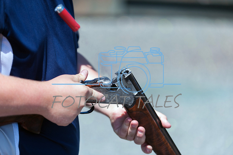 Brent Reinke, 18 and a member of the Carson City Hot Shots, poses with a $28,000 Beretta Gardone VT shotgun during the California Youth Shotgun Shooting Association's championship shootout at the Capitol City Gun Club in Carson City, Nev. on Saturday, May 2, 2015.<br /> Photo by Kevin Clifford/Nevada Photo Source