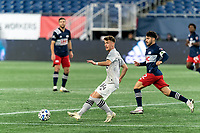 FOXBOROUGH, MA - NOVEMBER 20: Amar Sejdic #14 of Montreal Impact passes the ball as Carles Gil #22 of New England Revolution closes during the Audi 2020 MLS Cup Playoffs, Eastern Conference Play-In Round game between Montreal Impact and New England Revolution at Gillette Stadium on November 20, 2020 in Foxborough, Massachusetts.