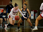 SIOUX FALLS, SD - MARCH 6: Liv Korngable #2 of the South Dakota Coyotes looks to drive past Ariel Walker #14 of the Oral Roberts Golden Eagles during the Summit League Basketball Tournament at the Sanford Pentagon in Sioux Falls, SD. (Photo by Dave Eggen/Inertia)