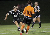 BOYDS, MARYLAND-JULY 07,2012:  Ashley Herndon (19) of DC United Women passes the ball by Deirdre Abouahmed (10) of Dayton Dutch Lions during a W League game at Maryland Soccerplex, in Boyds, Maryland. DC United women won 4-1.