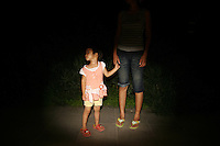CHINA. Beijing. A young child and her mother whilst watching the opening ceremony of the Beijing Summer Olympics. 2008