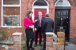 © Joel Goodman - 07973 332324 .  04/02/2014 . Sale , UK . L-R Rachel Reeves , Chris Bryant and Mike Kane knock on doors to canvas . Rachel Reeves , MP for Leeds West and Shadow Secretary of State for Work and Pensions and Chris Bryant , MP for Rhondda and Shadow Minister for Welfare Reform , join Labour candidate Mike Kane on the campaign trail ahead of the Wythenshawe and Sale East by-election , following the death of MP Paul Goggins . They visit the home of Tony Gunning (51) who suffers from hereditary adult polycystic kidney disease and is on dialysis , who says he is affected by the bedroom tax . Photo credit : Joel Goodman