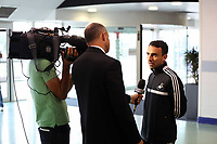 Wednesday 28 August 2013<br /> Pictured: Leon Britton (R) interviewed by Sky Sorts at Cardiff Airport.<br /> Re: Swansea City FC players and staff en route for their UEFA Europa League, play off round, 2nd leg, against Petrolul Ploiesti in Romania.