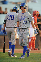 Burlington Royals center fielder Bubba Starling #23  reacts to a strike out during a game against the Johnson City Cardinals at Howard Johnson Field on June 28, 2012 in Johnson City, Tennessee. The Royals defeated the Cardinals 14-2. (Tony Farlow/Four Seam Images).