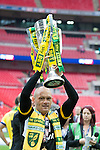 Norwich City 2 Middlesbrough 0, 25/05/2015. Wembley Stadium, Championship Play Off Final. Alex Neil celebrates with the trophy. A match worth £120m to the victors. On the day Norwich City secured an instant return to the Premier League with victory over Middlesbrough in front of 85,656. Photo by Simon Gill.