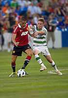 16 July 2010 Manchester United Federico Macheda No. 27 and  in action during an international friendly  between Manchester United and Celtic FC at the Rogers Centre in Toronto.16 July 2010 Manchester United Federico Macheda No. 27 and Celtic FC Simon Ferry No. 53  in action during an international friendly  between Manchester United and Celtic FC at the Rogers Centre in Toronto..Manchester United won 3-1.