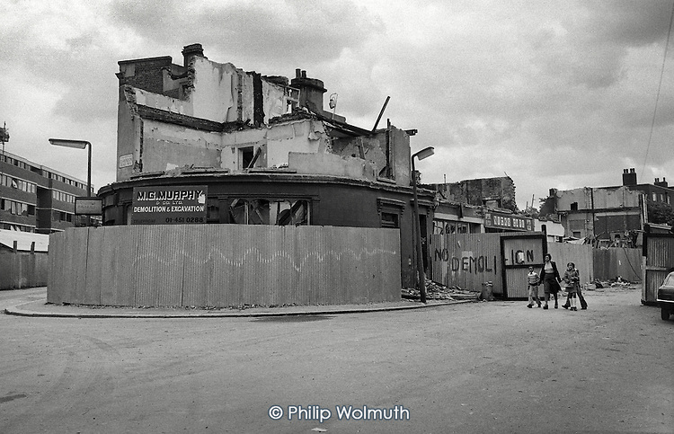 1975: demolition of shops and houses at the junction of Clarendon Road and Walmer Road, part of the Lancaster Road West Redevelopment area, Notting Hill, London.