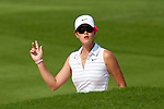 CHON BURI, THAILAND - FEBRUARY 19:  Michelle Wie of USA acknowledges to the crowd on the 12th hole during day three of the LPGA Thailand at Siam Country Club on February 19, 2011 in Chon Buri, Thailand. Photo by Victor Fraile / The Power of Sport Images