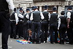 © Joel Goodman - 07973 332324 . 30/06/2011 . London , UK . Protesters surrounded by police sit and block Whitehall . Tens of thousands of public sector workers demonstrate and march through the City of London in protest at proposed changes to their pensions . Photo credit : Joel Goodman