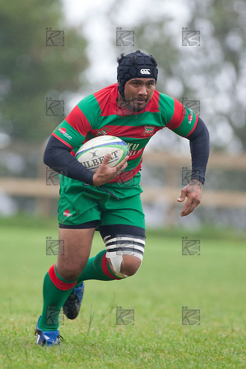 Sosefo Kata makes a midfield run during the Counties Manukau Premier Club Rugby game between Bombay and Waiuku played up on the hill at Bombay on March 26th 2011. Waiuku won 57 - 10 after leading 24 - 3 at halftime.