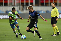 SAN JOSE, CA - OCTOBER 18: Jackson Yueill #14 of the San Jose Earthquakes is marked by Jordy Delem #8 of the Seattle Sounders during a game between Seattle Sounders FC and San Jose Earthquakes at Earthquakes Stadium on October 18, 2020 in San Jose, California.