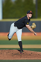 USC Trojans starting pitcher Mitch Hart (14) follows through on his delivery against the Wake Forest Demon Deacons at David F. Couch Ballpark on February 24, 2017 in  Winston-Salem, North Carolina.  The Demon Deacons defeated the Trojans 15-5.  (Brian Westerholt/Four Seam Images)