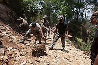 Nepali army clears a road in Sindhupalchok, outstrike of Kathmandu, Nepal. May 1, 2015