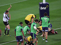 Referee Bryce Lawrence awards a try to Colin Slade during the Super 15 rugby match between the Hurricanes and Highlanders at Westpac Stadium, Wellington, New Zealand on Saturday, 17 March 2012. Photo: Dave Lintott / lintottphoto.co.nz