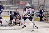 Ric Seiling (16) controls the puck in front of goalie Tom Askey (35) during The Frozen Frontier Buffalo Sabres vs. Rochester Amerks Alumni Game at Frontier Field on December 15, 2013 in Rochester, New York.  (Copyright Mike Janes Photography)