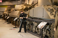 BNPS.co.uk (01202) 558833. <br /> Pic: CorinMesser/BNPS<br /> <br /> Pictured: Jon Giles uses his Ghostbusters style backpack vacuum to clean the tanks. <br /> <br /> Staff at the Tank Museum, Bovington are deep cleaning the exhibits ahead of reopening on Monday (17/05/21).