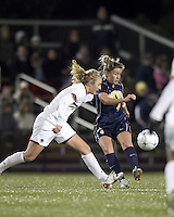 "West Virginia midfielder Bri Rodriguez (4) passes the ball as Boston College midfielder Kate McCarthy (21) defends. Boston College defeated West Virginia, 4-0, in NCAA tournament ""Sweet 16"" match at Newton Soccer Field, Newton, MA."