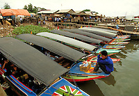 Water taxis along the Musi River near the city of Palembang, Indonesia provide the primarly means of transportation for passengers and their cargo. boat, boats,. Water Taxis on Musi River. Palembang, Indonesia Musi River.