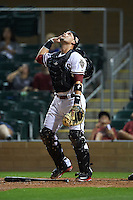 Salt River Rafters catcher Oscar Hernandez (25) watches a popup during an Arizona Fall League game against the Scottsdale Scorpions on October 13, 2015 at Salt River Fields at Talking Stick in Scottsdale, Arizona.  Salt River defeated Scottsdale 5-3.  (Mike Janes/Four Seam Images)