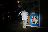 CHINA. Beijing. A man using a telphone at a mall kiosk. 2008.