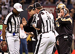 December 2009: New Orleans Saints head coach Sean Payton discusses a play with referees during an NFL football game at the Louisiana Superdome in New Orleans.  The Buccaneers defeated the Saints 20-17.