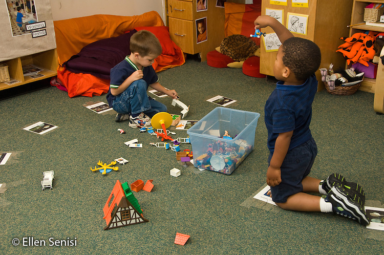 MR / College Park, Maryland.Center for Young Children, laboratory school within the College of Education at the University of Maryland. Full day developmental program of early childhood education for children of faculty, staff, and students at the university..Two boys (left: 3; right:3, African American) playing with same toys on classroom floor..MR: Mai1 Opp2.© Ellen B. Senisi