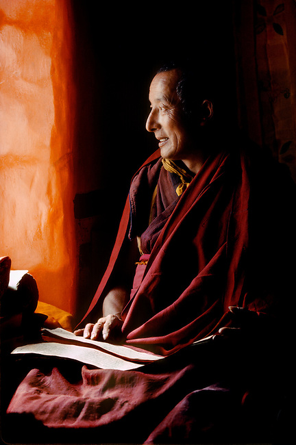 The Ma Shee Lama of Sera Gompa in his quarters reading the scriptures,  Lhasa, Tibet