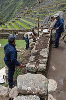 Peru, Machu Picchu.  Workers Carrying out Maintenance.