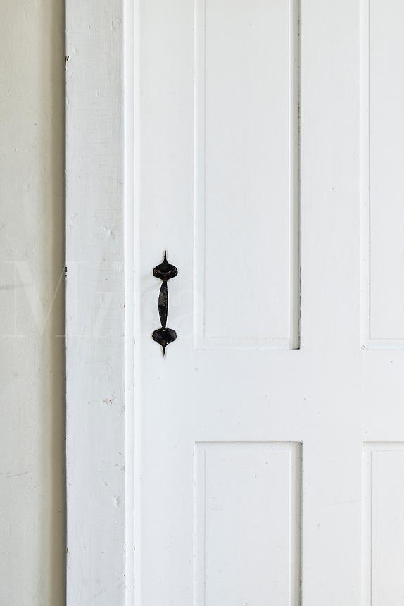 Door detail in rural home.