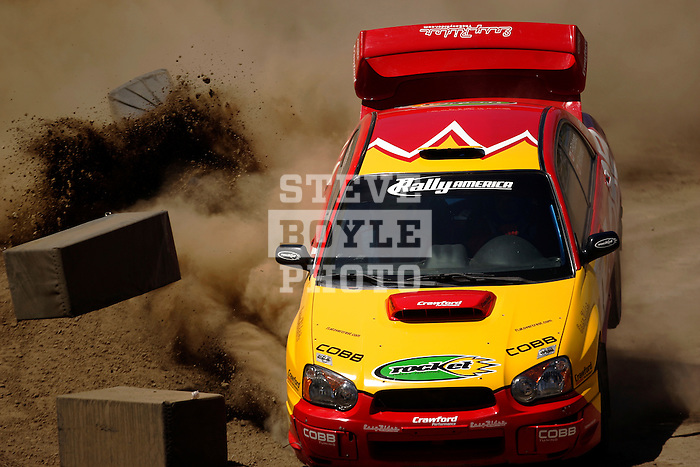 Driver Patrick Richard and co-driver Nathalie Richard crash as they come around a turn near the finish line while competing in the Rally Car Race finals during X-Games 12 in Los Angeles, California on August 5, 2006.
