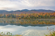 Northern Presidential Range from Durand Lake in Randolph, New Hampshire USA during the autumn months.