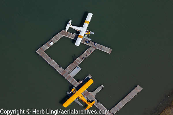 Two DeHavilland Beavers, both DHC-2 MK 1 models, N5220G and N123JL, docked at the piers at the Commodore Center Seaplane Base (22CA) in Sausalito, California
