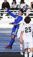 NWA Democrat-Gazette/CHARLIE KAIJO Rogers High School midfielder Andres Saldierna (15) heads the ball during a soccer game, Friday, April 26, 2019 at  Whitey Smith Stadium at Rogers High School in Rogers.