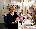 """London, UK. 04.03.2016. Sian Wolchover, Principal Dresser on musical """"Billy Elliott"""", in Ruthie Henshall's dressing room, where she dresses Ms Henshall. Sian has worked on """"Billy Elliott"""" for 11 years, and says because of the length of time people have worked on the show, there is a warmth and camaraderie akin to being part of a big family. Starting in 1981, from the Guildhall technical course, Sian's career has spanned being a dresser, wardrobe mistress and props buyer, across the West End and beyond, from musicals (including stints on CATS, Aspects of Love), to opera (freelance props buyer for ENO), and straight theatre (including """"Cards on the Table"""" at the Vaudeville, her first job out of college).  Photograph © Jane Hobson."""