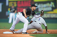 Carlos Sanchez (13) of the Charlotte Knights fields a throw as Jose Constanza (1) of the Louisville Bats steals second base at BB&T BallPark on May 12, 2015 in Charlotte, North Carolina.  The Knights defeated the Bats 4-0.  (Brian Westerholt/Four Seam Images)