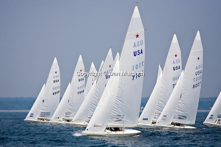 Fleet of Star boats racing close hauled