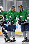 Notre Dame Fighting Irish of Batavia forward Bryce Polito (18) and Bryan Moscicki (22) during a varsity ice hockey game against the Brockport Blue Devils during the Section V Rivalry portion of the Frozen Frontier outdoor hockey event at Frontier Field on December 22, 2013 in Rochester, New York.  (Copyright Mike Janes Photography)