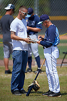 Tampa Bay Rays coach Jim Morrison signs autographs before a minor league Spring Training game against the Boston Red Sox on March 23, 2016 at Charlotte Sports Park in Port Charlotte, Florida.  (Mike Janes/Four Seam Images)