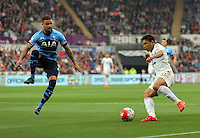 Jefferson Montero of Swansea (R) crosses the ball over Kyle Walker of Tottenham Hotspur, to team mate Andre Ayew of Swansea who scored the opening goal during the Barclays Premier League match between Swansea City and Tottenham Hotspur played at The Liberty Stadium, Swansea on October 4th 2015