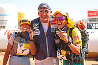 8th October 2021; Boulchrhal to Sud Jebel Irhfelt N'Tissalt ; Marathon des Sables, stage 5 and final stage of a six-day, 251 km ultramarathon, which is approximately the distance of six regular marathons. The longest single stage is 91 km long. This multiday race is held every year in southern Morocco, in the Sahara Desert. Aziz Raji (mor) crosses the line as ladies winner holding hands with compatriot HAMDOUCH Hassna (Mor) and Patrick Bauer