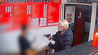Pictured: CCTV showing Paul Griffiths pulling a paintball gun inside the Rhondda takeaway in Wales, UK.<br /> Re: Paul Griffiths, who pointed an imitation firearm at a kebab shop owner – after he was told to wait outside the shop because he refused to wear a mask – has been jailed by Magistrates in Merthyr Tydfil, Wales, UK.<br /> Paul Griffiths, 57, walked into the Rhondda Takeaway on November 5 and tried to order food. <br /> But when asked to put on a mask he refused, so was told to wait outside.<br /> As the owner tried to explain why he was asking him to put on a mask, Griffiths pulled an imitation firearm from his pocket before pointing it at people inside the shop.